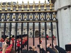 Changing of the guard featuring tourist hands.